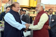 Lahore: Prime Minister Narendra Modi being received by the Prime Minister of Pakistan Nawaz Sharif, at Lahore, Pakistan on Dec 25, 2015. (Photo: IANS/PIB)