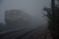 A local train gets delayed due to fog. (File Photo: IANS)