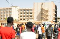 OUAGADOUGOU, Jan. 16, 2016 (Xinhua) -- People gather outside the Splendid Hotel in Burkina Faso's capital Ouagadougou, Jan. 16, 2015. Twenty-three people have been killed and many others wounded after the Al-Qaida in the Islamic Maghreb (AQIM) attacked the Splendid Hotel and took hostages there Friday. Security forces have freed 126 hostages and killed four attackers on Saturday. (Xinhua/IANS)