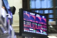 US stocks open lower after Fed releases latest data