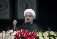 Iran says ready for nuclear talks if US lifts sanctions