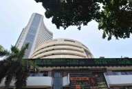 Market gives thumbs-up to exit polls, ends 1,422 pts up (3rd Lead)
