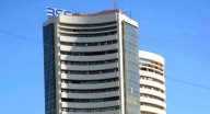 Sensex gains 250 points amid volatility, Nifty above 9,100 (Lead)