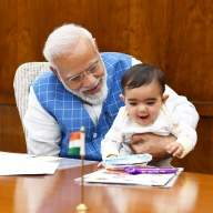 PM's photo with toddler goes viral, child identified (Lead)