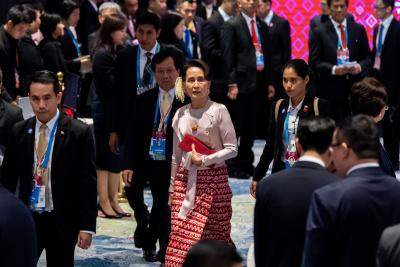 Suu Kyi in court 1st time since military coup (Ld)