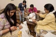 Corona warriors: Union minister's wife stitches masks at home