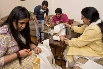 Corona warriors: Union minister's wife stitches masks at hom...