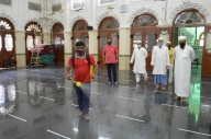 B'luru temples, mosque sanitise premises before reopening
