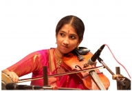 At 16, ruling the violin's 4 strings and teaching students