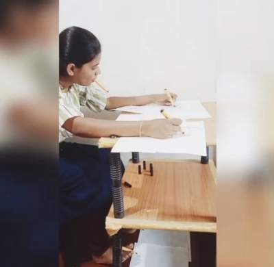 This Kerala student draws using her hands, feet and mouth