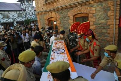 Huge turnout at police officer's funeral reminds one of Kashmir's complex reality